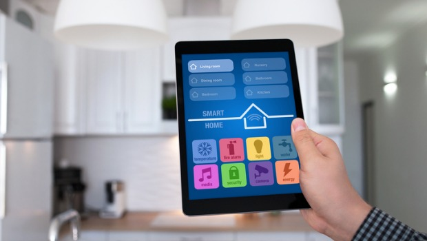 male-hand-holding-tablet-app-smart-home-kitchen-in-house-picture-id647343286.jpg